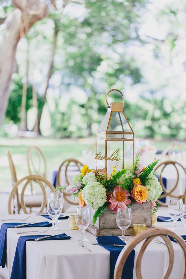 Gold lantern floral centerpieces by Branch Design Studio in Charleston, SC