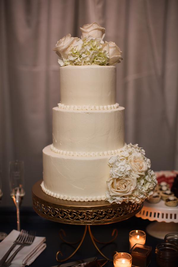 Three-tiered white wedding cake at The Beaufort Inn