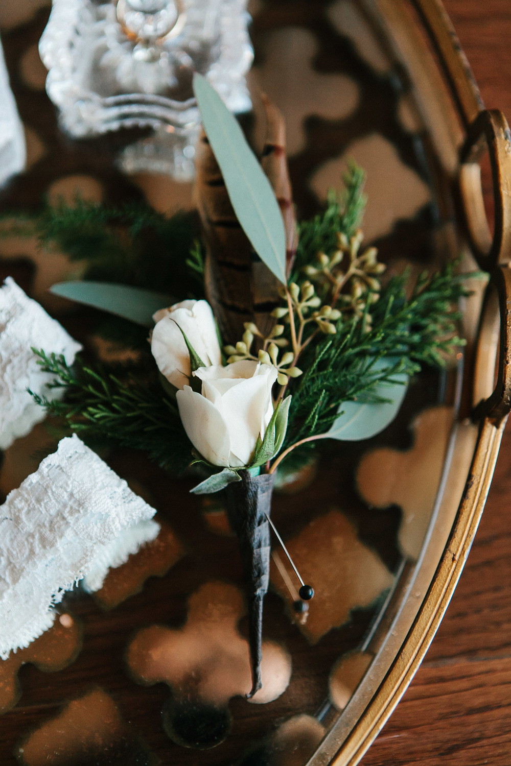Pheasant feather boutonniere winter wedding in Stillmore, GA by Mark Williams Studio