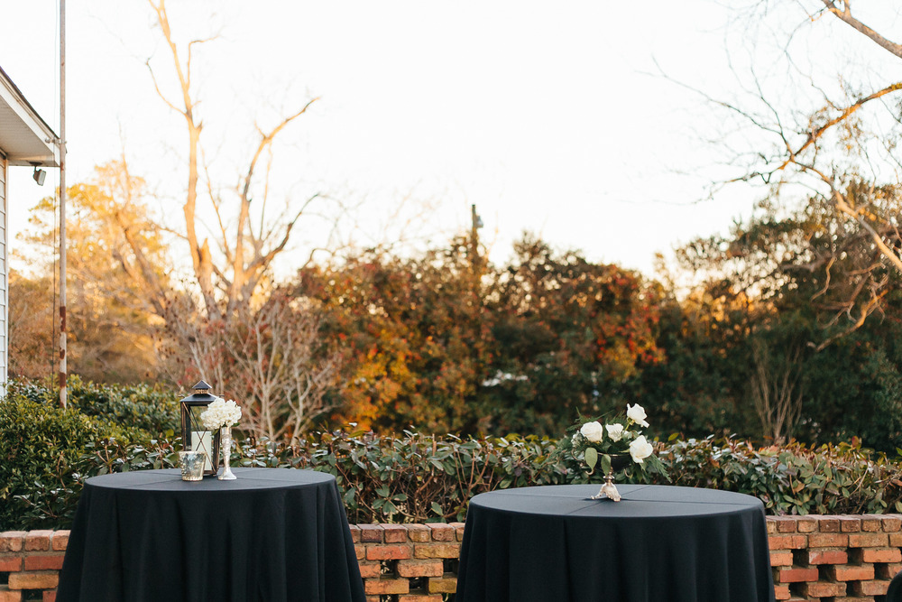 Black table linens and white centerpeices for Georgia wedding