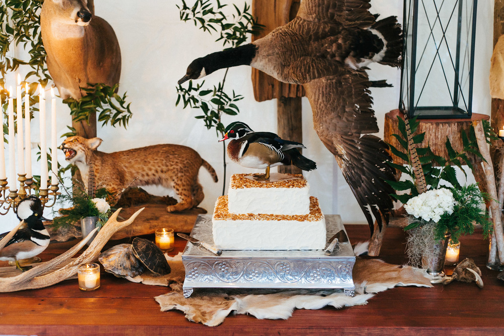 Woodland inspired Georgia wedding with rustic details, antlers, furs and taxidermy animals