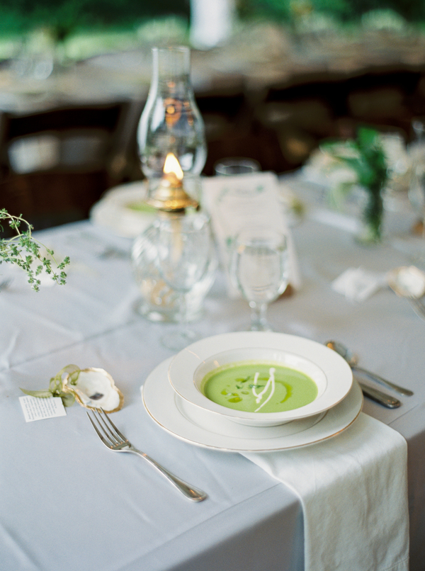 Natural wedding decor with glass oil lamps by Confetti of Charleston