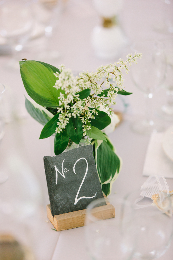 Natural wedding decor by Confetti of Charleston - handmade slate table numbers