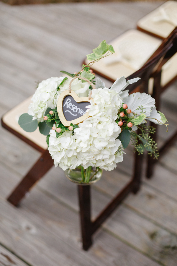 Hydrangea and eucalyptus wedding ceremony flowers at Mingo Point