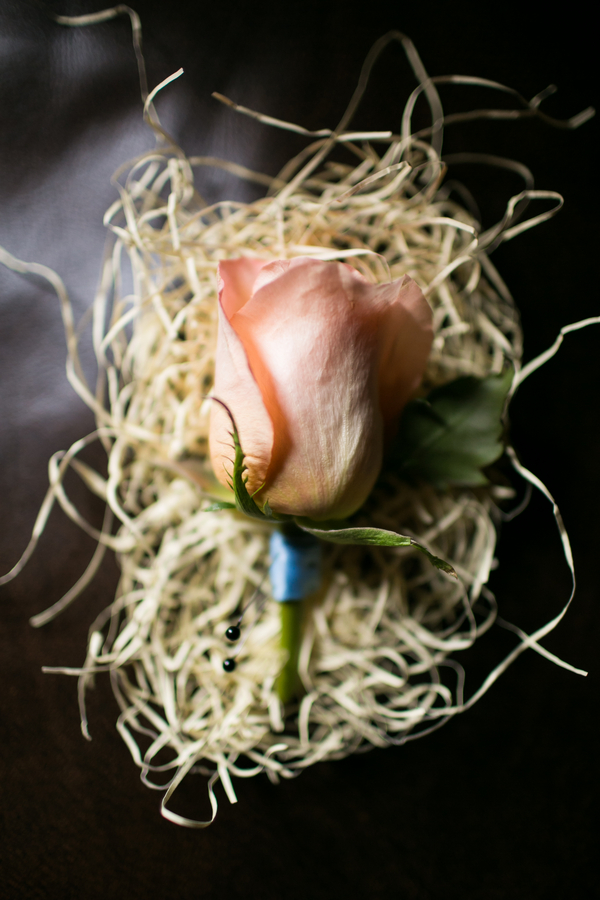 Peach rose boutonniere by Savannah, GA wedding florist Garden on the Square