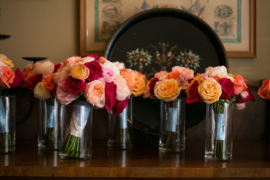 Deep pink roses, peach garden roses and orange ranunculus bouquet from Garden on the Square at Savannah wedding