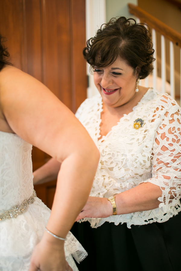 Mother of the Bride helping daughter get ready for Savannah, GA wedding by anna and Spencer Photography