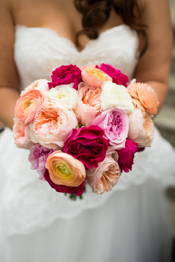 Savanna wedding Bouquet of peach garden roses, pink roses and peach ranunculus by Garden on the Square