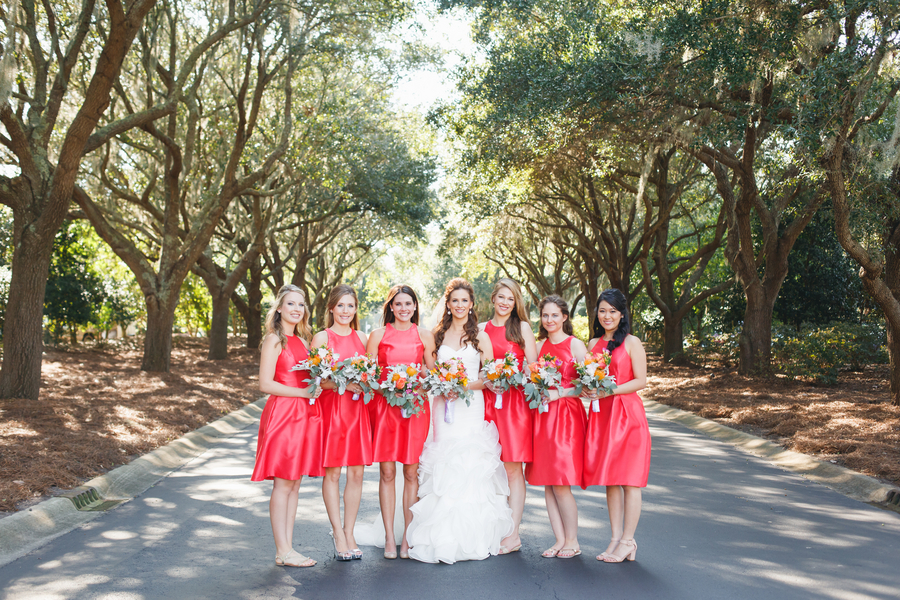 Poppy colored bridesmaids dresses at Erin + Ronaldo's DeBordieu Club wedding by Riverland Studios .