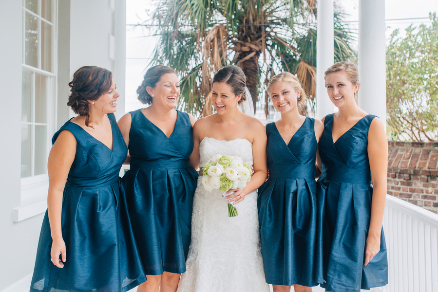 Peacock blue V-neck bridesmaids dresses at Gadsden House wedding in Charleston, SC by Riverland Studio.