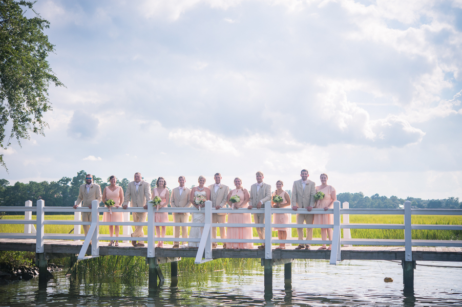 CHARLESTON WEDDINGS - Bridal party in peach and tan suits at Summer wedding at Creek Club at I'On by Molly Joseph Photography