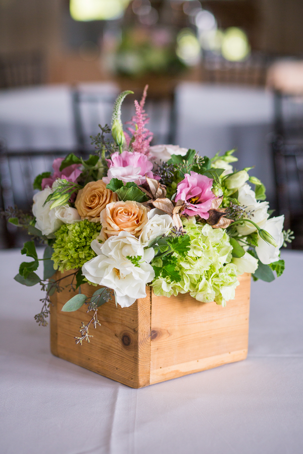 CHARLESTON WEDDINGS - Summer centerpieces by Ooh! Events with pink and peach roses, green hydranges and astilbe