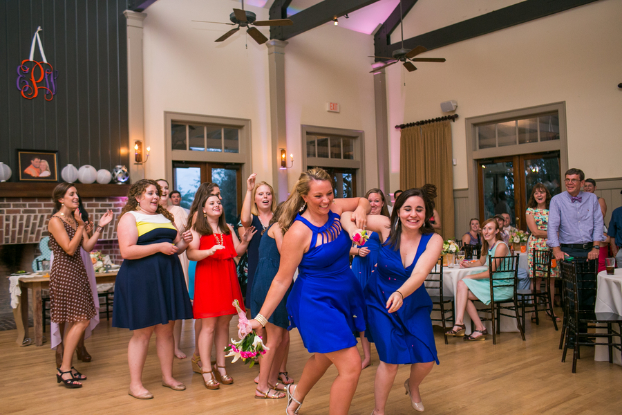 CHARLESTON WEDDINGS - bouquet toss at Creek Club at I'On wedding by Molly Joseph Photography