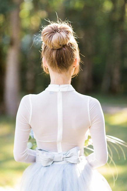 Bride wearing a high bun with grey tulle wedding skirt for Portland Oregon elopement