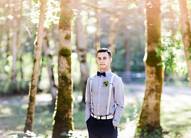 Groom wearing a bow tie, suspenders and berry boutonniere at Bohemian inspired elopement
