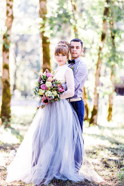 Bride in a grey tulle wedding skirt with Groom in suspenders and bow tie