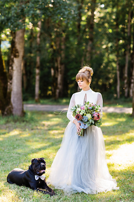 Bohemian bride in a grey tulle wedding skirt with her rescue dog