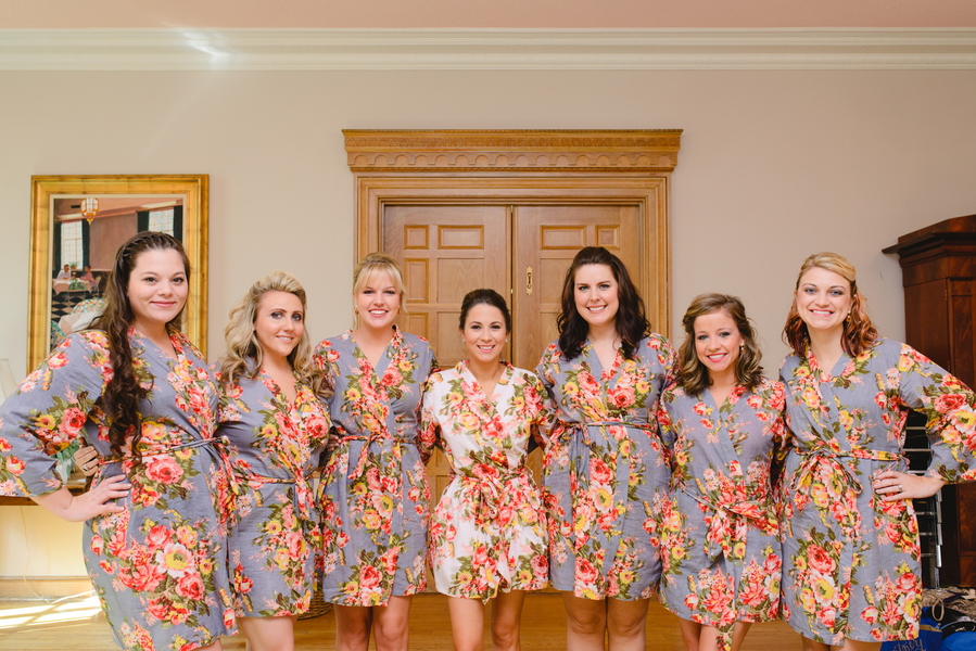 Bridesmaids in floral robes prepping for Charleston, SC wedding