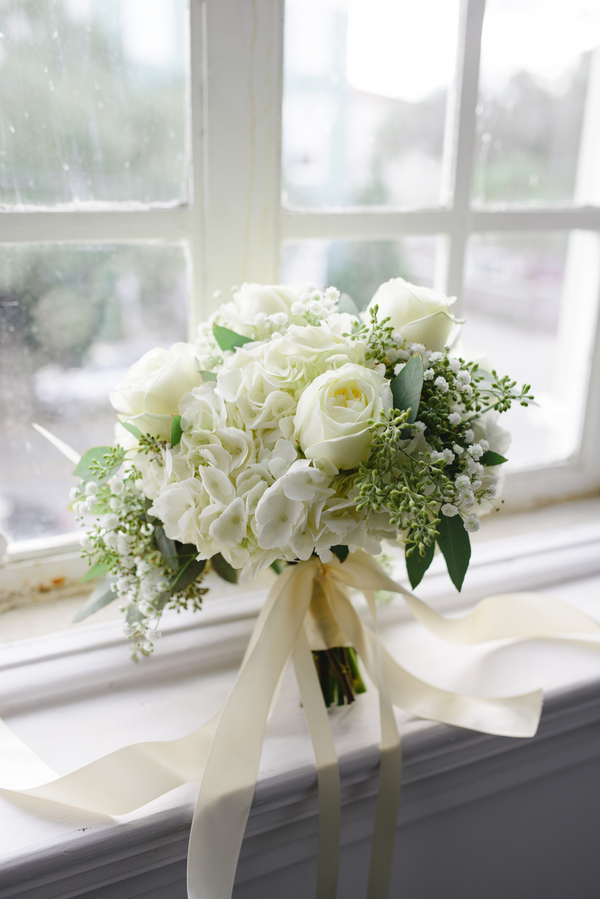 White hydrangea and rose bouquet by Fresh by Frampton's Flowers in Charlseton, Sc