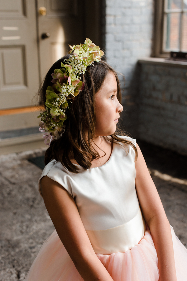 Flower girl wearing floral crown at Georgia wedding in Savannah