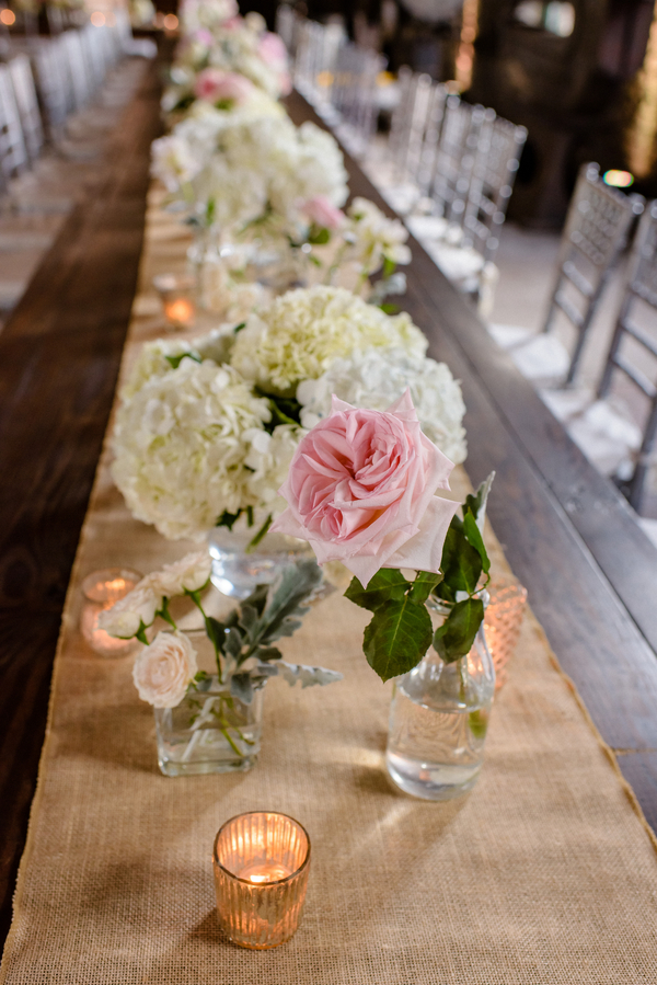 Burlap table runners with white hydrangeas and pink garden roses at Georgia State Railroad Museum wedding