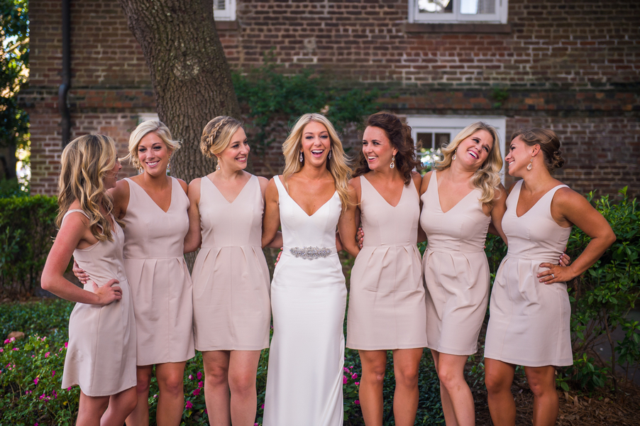 Bridesmaids in light pink dresses at The Historic Rice Mill Building