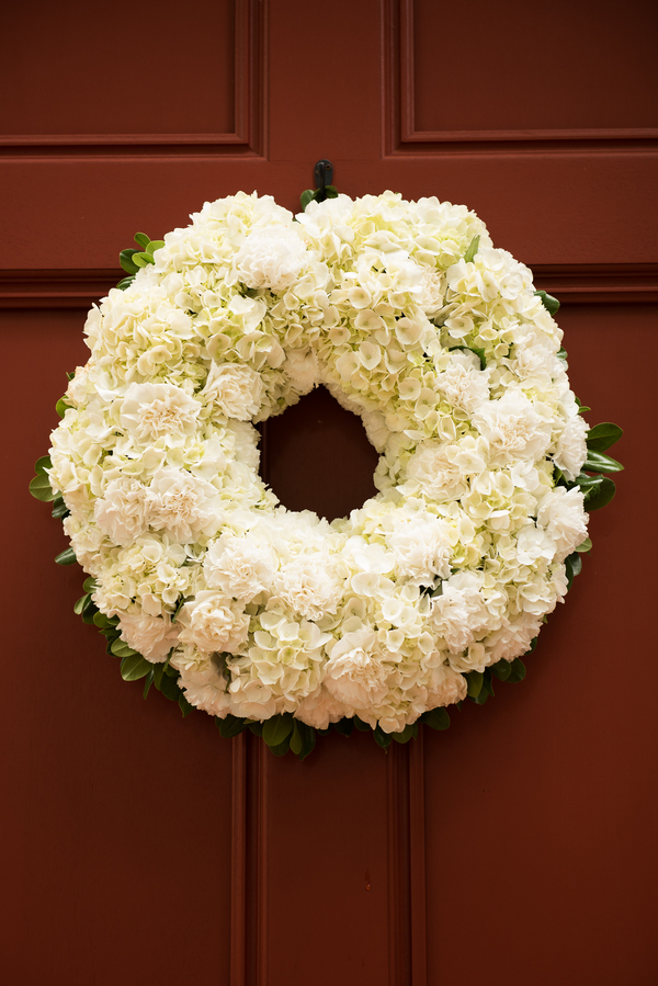 White Hydrangea wedding chapel wreaths by Palmetto Petals in Charleston, Sc