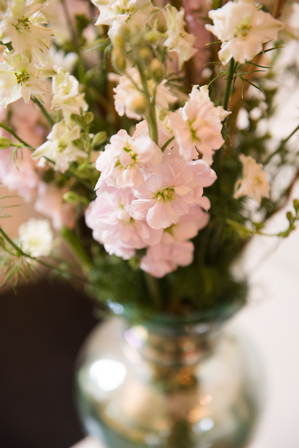 White hydrangeas and pink rose centerpieces by Palmetto Petals