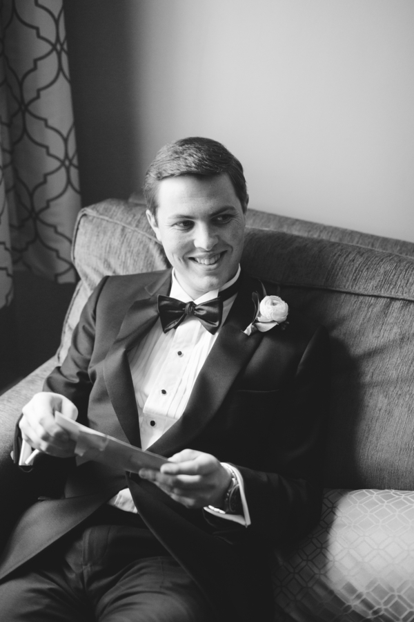 Groom reading note from bride before Charleston wedding
