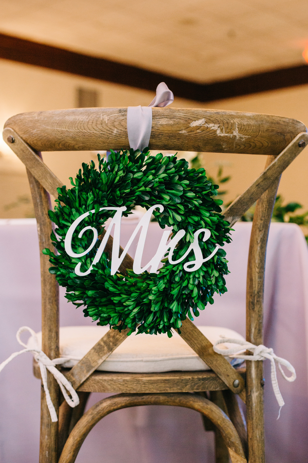 Green wreath chair decor at Charleston wedding