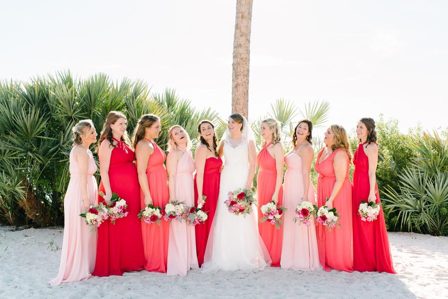 Long Pink + Red Bridesmaids dresses at Charleston wedding