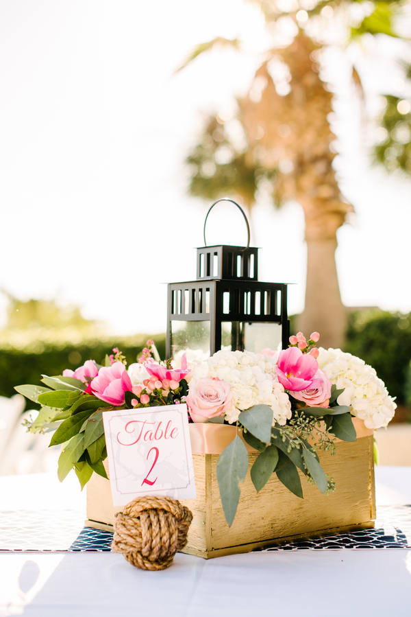 Centerpieces of Pink tulip, white hydrangea with lanterns at Lowcountry wedding by Pretty Petals of Charleston