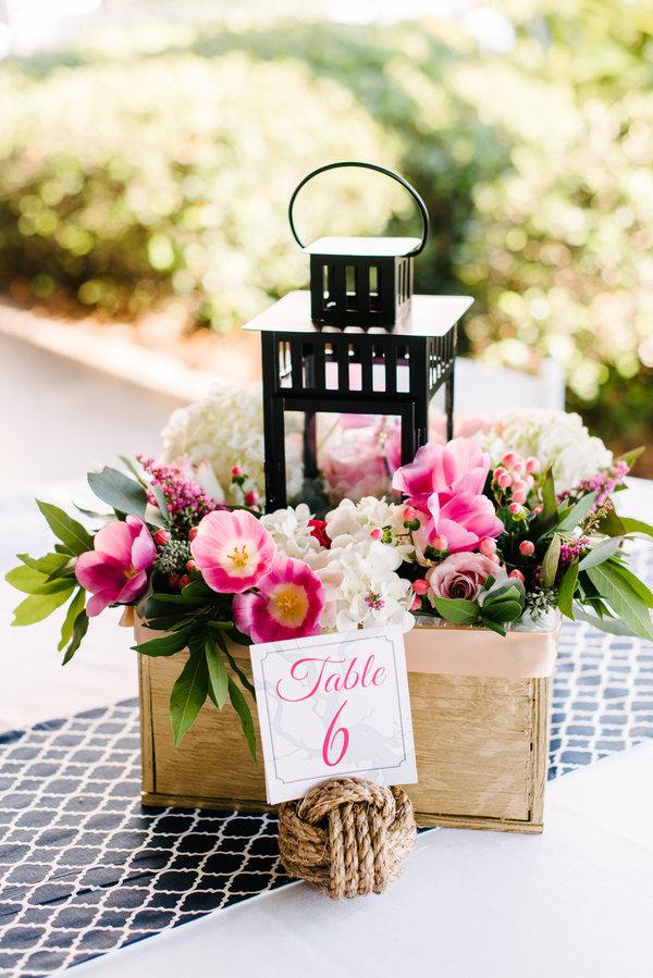 Pink tulip and white hydrangea lantern centerpieces by South Carolina wedding vendor Pretty Petals of Charleston