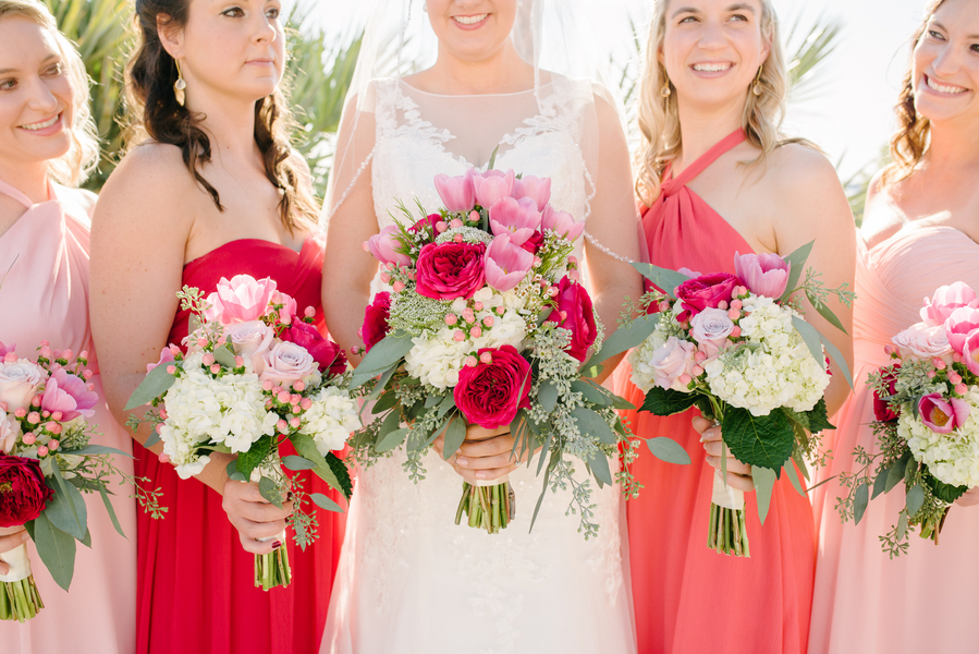 Long Pink + Red Bridesmaids dresses at Charleston wedding
