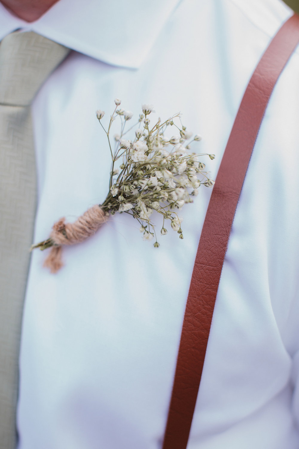Baby's breath boutonniere at at Rustic Magnolia Plantation wedding in Charleston, SC
