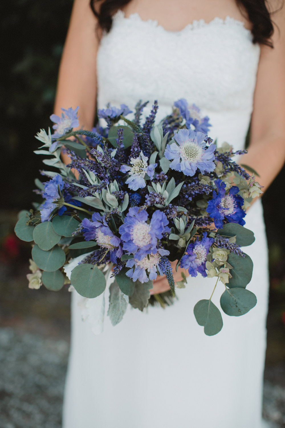 Rustic purple bouquet with seeded eucalyptus at Magnolia Plantation