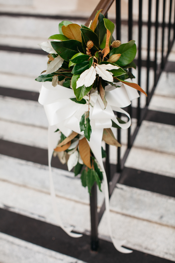 Magnolia leave pew markers at Charleston wedding by The Flower Cottage
