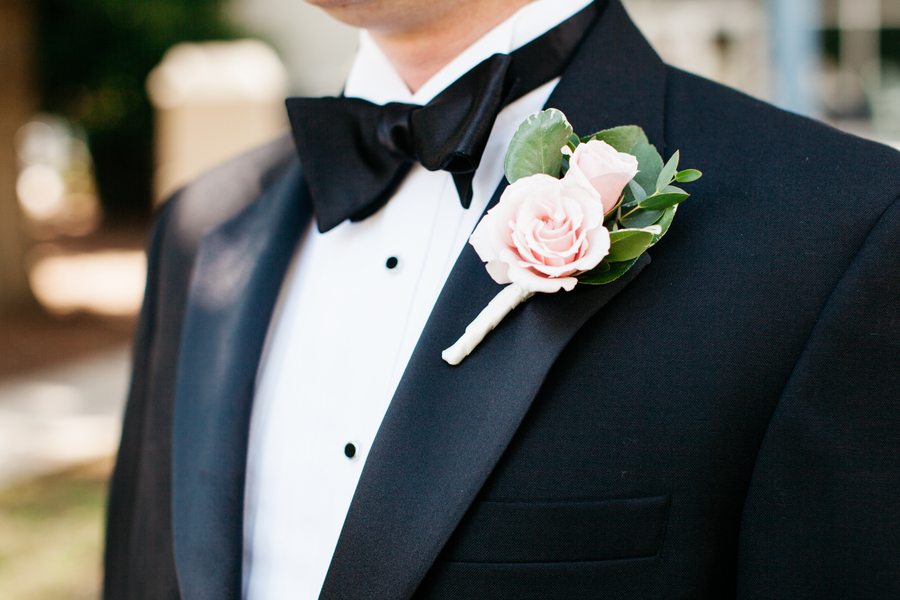 Pale pink rose boutonniere by Charleston wedding vendor The Flower Cottage