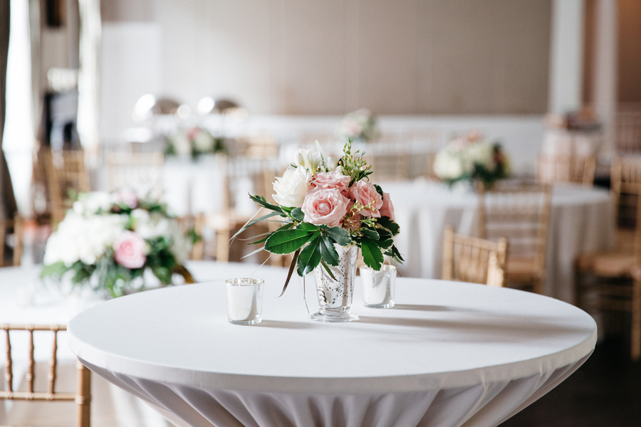 Pink and white rose centerpieces at Hibernian Hall wedding