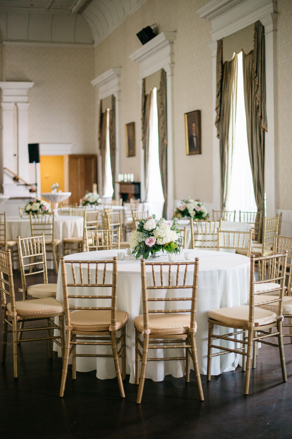 Elegant Hibernian Hall wedding in Charleston, South Carolina with gold chivari chairs