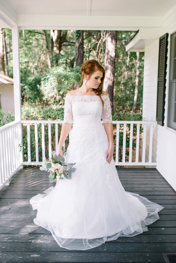 Long sleeved, lace wedding dress by Cana Dunlap Photography