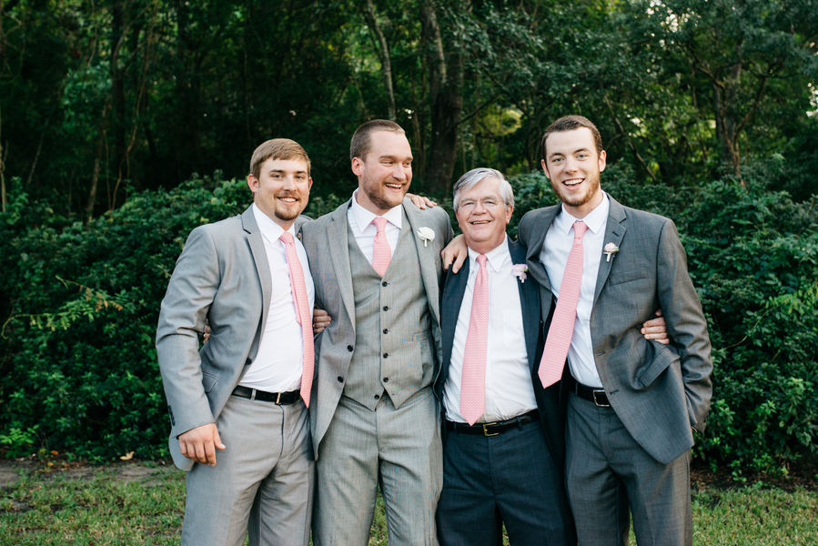 Groomsmen in grey suits soft pink ties at Lowcountry wedding