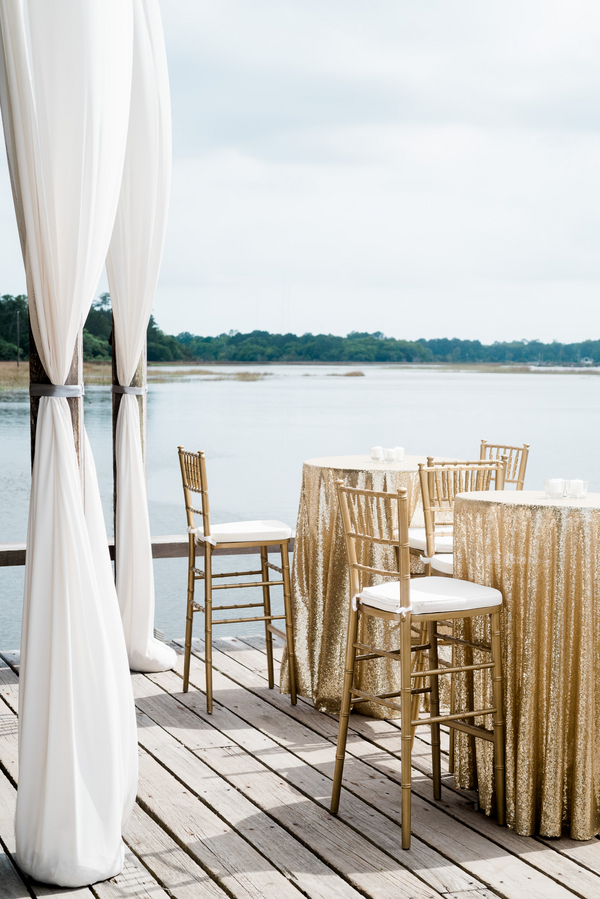 Gold sparkly linens on the dock at Lowcountry wedding