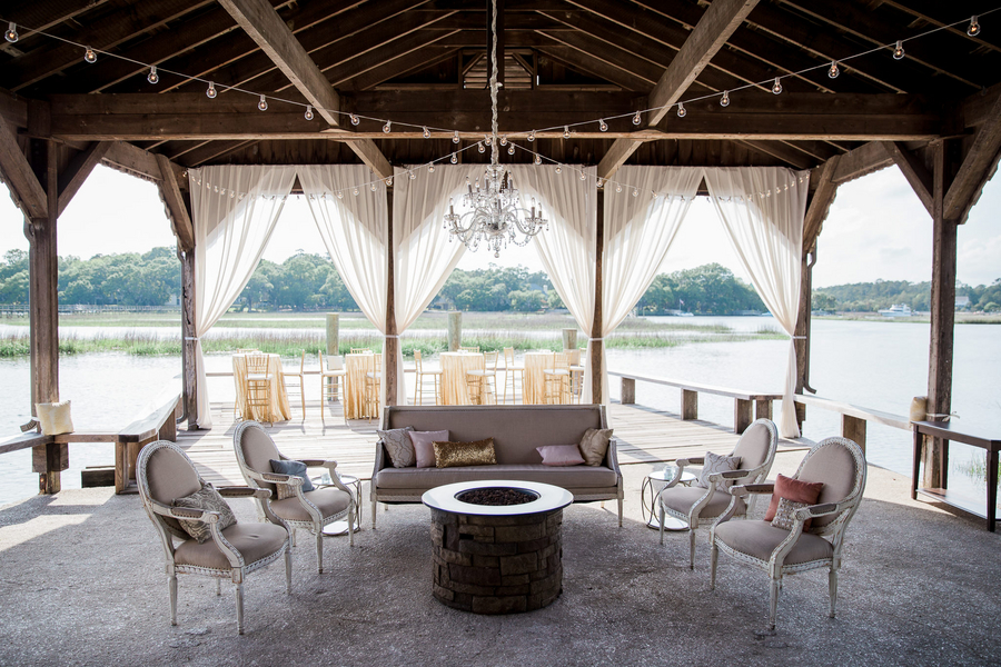 Lounge furniture at the Cotton Dock overlooking the water