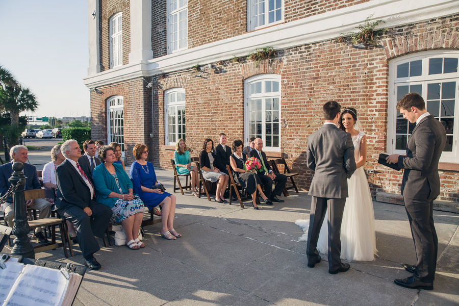 Intimate outdoor ceremony overlooking the water at The Historic Rice Mill Building