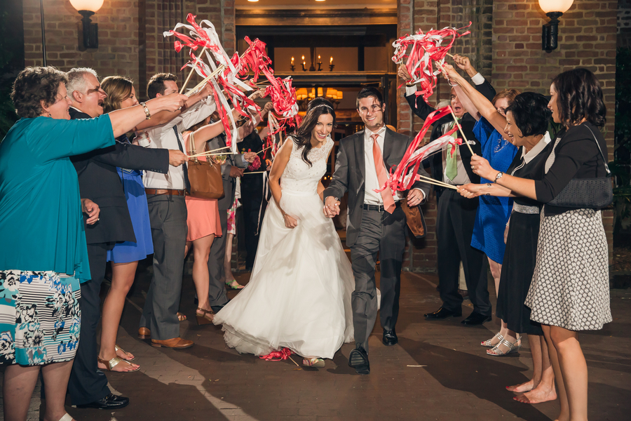 Bride and Groom depart under ribbon wands