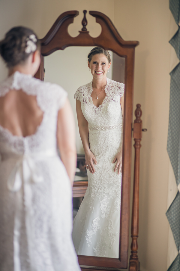Charleston bride in a lace dress with keyhole back