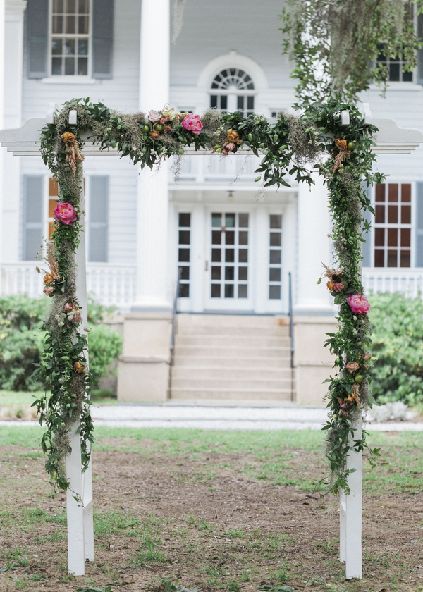 Glamorous McLeod Plantation ceremony arch from Wildflowers Inc. in Charleston, SC