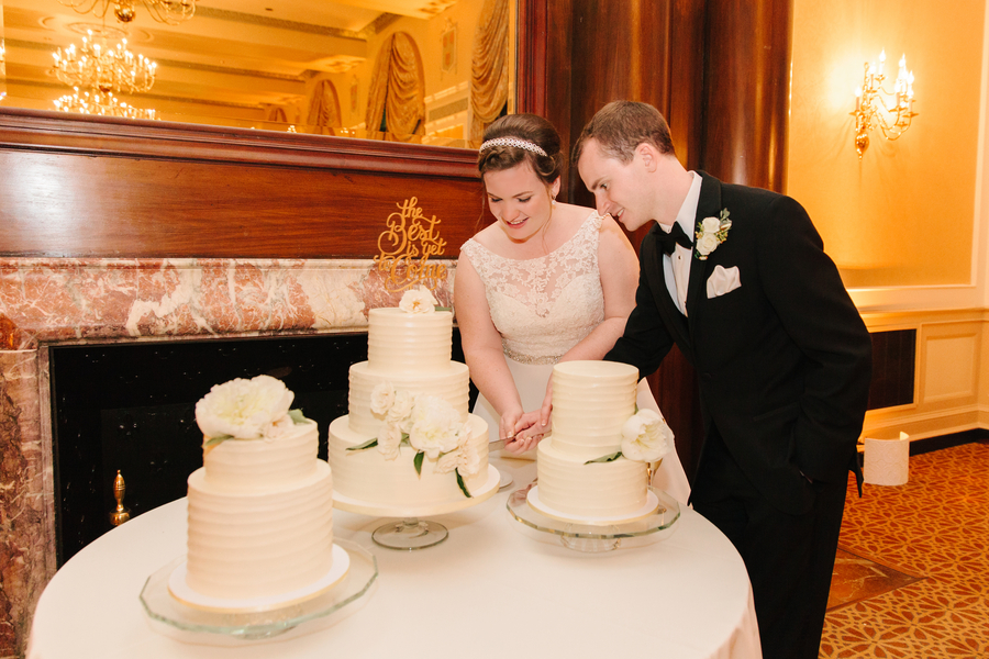 Cake cutting at Elegant Charleston wedding reception at The Francis Marion Hotel