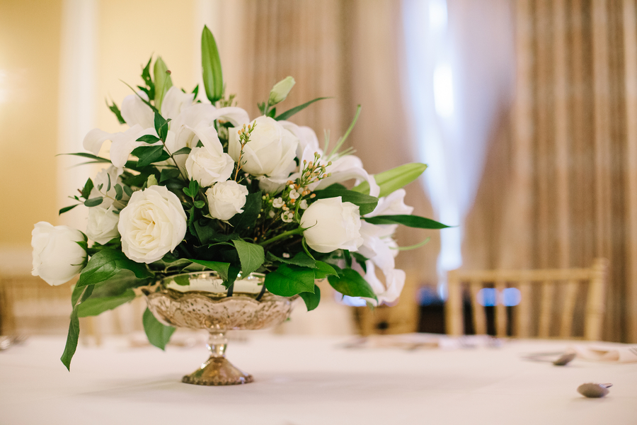 White rose and lily centerpiece by Country & Lace florist in Charleston, SC